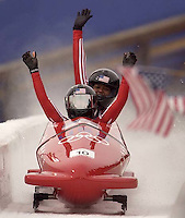 USA gold medalists Jill Bakken (front) and Vonetta Flowers celebrate their track record first run. Women's Bobsled, Tuesday evening at the Utah Olympic Park, 2002 Olympic Winter Games.; 02.19.2002, 4:57:57 PM<br />