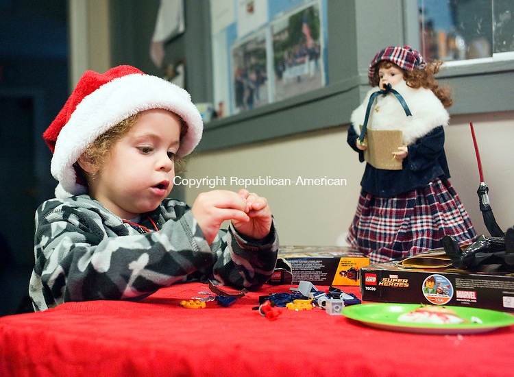 TORRINGTON, CT- 22 December 2015-122215CM01-  Mason Ryan 3, of Torrington plays with toys at FISH (Friends in Service to Humanity) in Torrington on Tuesday.  FISH held a Christmas party which featured an accordion player, cookies and Santa for the families and children who live there.  Christopher Massa Republican-American