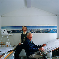 Robin and Lucienne Day sit in their design studio amongst proto-types and models of their designs