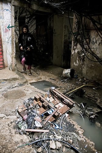A palestinian woman in the camp of Burj el Barajneh, south of Beirut, Lebanon. Some areas of the camp are undergoing sewage stystem repairs, financed by the UNRWA.<br /> <br /> Dans le d&eacute;dales des ruelles du camp palestinien de Burj El Barajneh, au sud de Beyrouth
