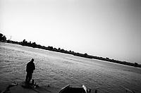 ROMANIA, 06.2002, Mila 23, Delta of Danube..The village of Mila 23 is located on the former main branch of the Danube Delta. Away from the main channels of communication, life depends exclusively on the River. Overfishing and pollution of the various waters of the Danube are today threatening the traditional lifestyle of the fishermen Lipovans..ROUMANIE, 06.2002, Mila 23, Delta du Danube..Le village de Mila 23 est situé sur l'ancien bras principal du delta du Danube. A l'écart des principales voies de communication, la vie y dépend exclusivement du fleuve. La surpêche et les différentes pollutions des eaux du Danube mettent aujourd'hui en péril le mode de vie ancestral de ces pêcheurs lipovènes..© Bruno Cogez / Est&Ost Photography.