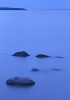 Rocks in Lake Winnipeg at dawn, Hecla Provincial Park, Manitoba, Canada