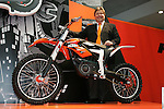 """Mar 26, 2010 - Tokyo, Japan - Harald Plöckinger of KTM Motorcycle AG poses with an electrically driven sports motorcycle called """"Freeride"""" for offroad and supermoto riders during the 37th Tokyo Motorcycle Show at Tokyo Big Sight on March 26, 2010. This 'zero emission motorcycle' will go on sale on 2011, according to the Austrian company. (Photo Laurent Benchana/Nippon News)"""