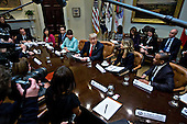 U.S. President Donald Trump, center, speaks as he meets with small business leaders in the Roosevelt Room of the White House in Washington, D.C., U.S., on Monday, Jan. 30, 2017. Trump defended the immigration clampdown that sparked a global backlash over the weekend by blaming the confusion at airports on protesters and on a computer outage at Delta Air Lines Inc. that caused flight cancellations. <br /> Credit: Andrew Harrer / Pool via CNP