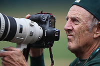 OAKLAND, CA - APRIL 4:  Team photographer Michael Zagaris of the Oakland Athletics works during the game against the Boston Red Sox at the Oakland Coliseum on Thursday, April 4, 2019 in Oakland, California. (Photo by Brad Mangin)