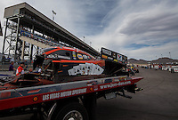 Apr. 5, 2013; Las Vegas, NV, USA: Pieces from the carbon fiber body from the car of NHRA funny car driver Johnny Gray after an explosion during qualifying for the Summitracing.com Nationals at the Strip at Las Vegas Motor Speedway. Mandatory Credit: Mark J. Rebilas-
