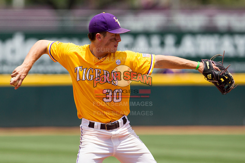 LSU Tigers shortstop Alex Bregman (30) makes a throw to first base against the Texas A&M Aggies in the NCAA Southeastern Conference baseball game on May 11, 2013 at Blue Bell Park in College Station, Texas. LSU defeated Texas A&M 2-1 in extra innings to capture the SEC West Championship. (Andrew Woolley/Four Seam Images).