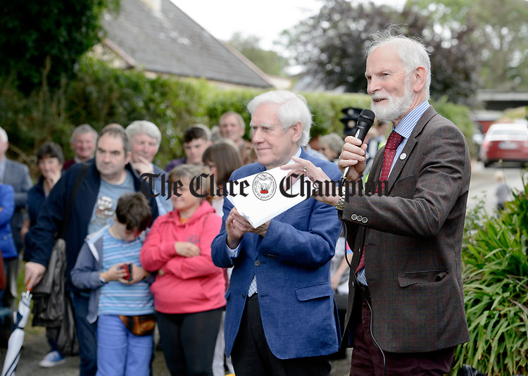 Frank Whelan, chairman of Fleadh 2017 Ennis speaking watched by Labhrás Ó Murchú, Director-General of Comhaltas Ceoltóirí Éireann at the unveiling of a memorial at the house where the blind piper Patrick O Brien was born at Labasheeda. Photograph by John Kelly.