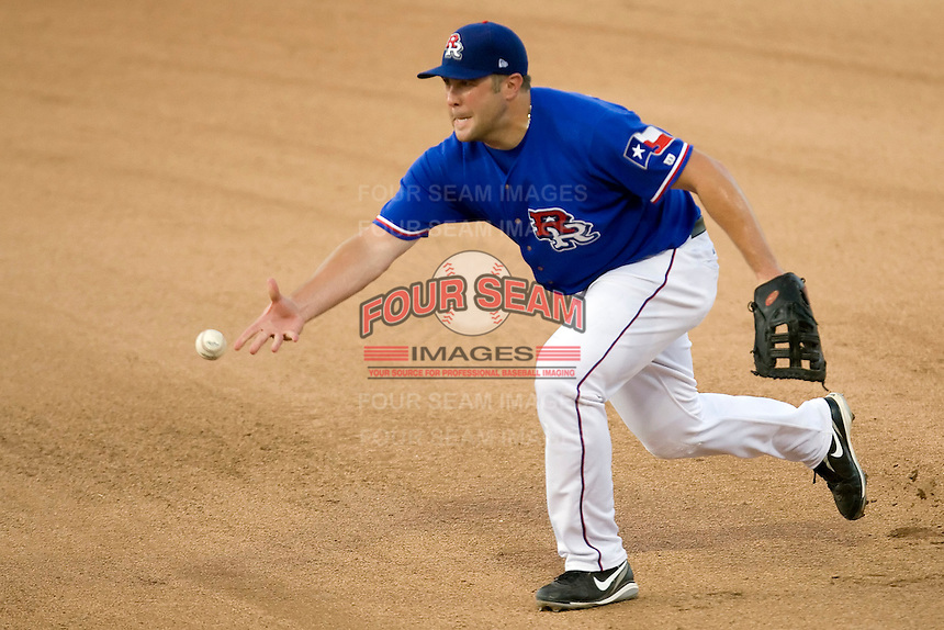 Round Rock Express first baseman Brad Nelson #30 tosses the ball to the pitcher during a Pacific Coast League game against the Salt Lake Bees at The Dell Diamond in Round Rock, Texas on August 6, 2011. Round Rock defeated Salt Lake 3-1.  (Andrew Woolley/Four Seam Images)
