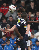 Darren McGregor beats Jordan Slew in the air in the St Mirren v Ross County Scottish Professional Football League Premiership match played at St Mirren Park, Paisley on 3.5.14.