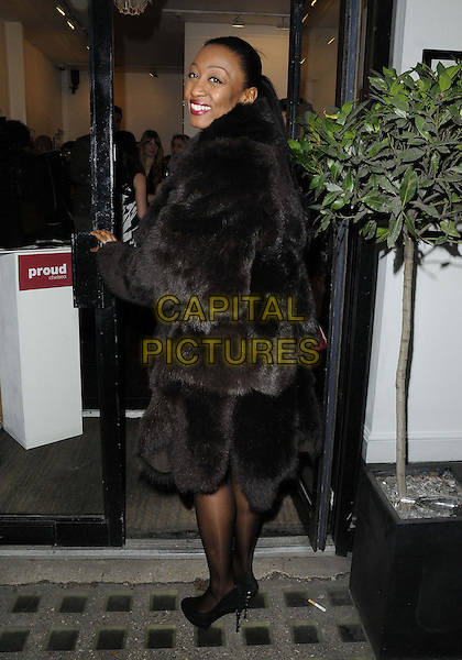 Beverley Knight.attended the Ossie Clark: The King of The King's Road Reigns Again exhibition private view, Proud Chelsea Gallery, King's Road, London, England, UK, 20th February 2013..full length brown fur coat black tights shoes back rear behind over shoulder smiling .CAP/CAN.©Can Nguyen/Capital Pictures.