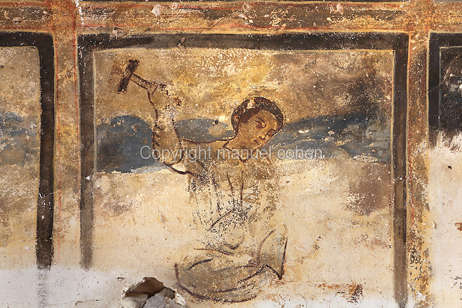 Fresco on vaulted ceiling of hall, Qasr Amra, Jordan. This fresco is divided into squares and depicts various forms of work, maybe relating to the building of the castle. Here we see a stonemason working with a hammer. These early Islamic frescoes have strong Persian and Byzantine influences. The original castle complex was built in 723-743 by Walid Ibn Yazid, the future Umayyad Caliph Walid II. It was a fortress with military garrison and residence of the Umayyad Caliphs. Today only the royal pleasure cabin remains, with reception hall and hammam or bath house. Picture by Manuel Cohen
