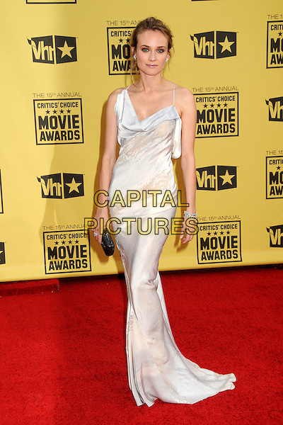 DIANE KRUGER .15th Annual Critics' Choice Movie Awards - Arrivals held at the Hollywood Palladium, Hollywood, California, USA, 15th January 2010..full length long maxi dress  white cream silk  black clutch bag bracelets.CAP/ADM/BP.©Byron Purvis/Admedia/Capital Pictures