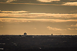 © Joel Goodman - 07973 332324 . 07/12/2013 . View south from the city centre with Jodrell Bank (left) and Manchester Airport control tower (right) . Cityscape view of Manchester . Photo credit : Joel Goodman