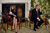 US President Donald Trump and the First Lady Melania Trump participate in NORAD Santa Tracker phone calls in the East Room of the White House in Washington, D.C on December 24, 2018.<br /> Credit: Olivier Douliery / Pool via CNP