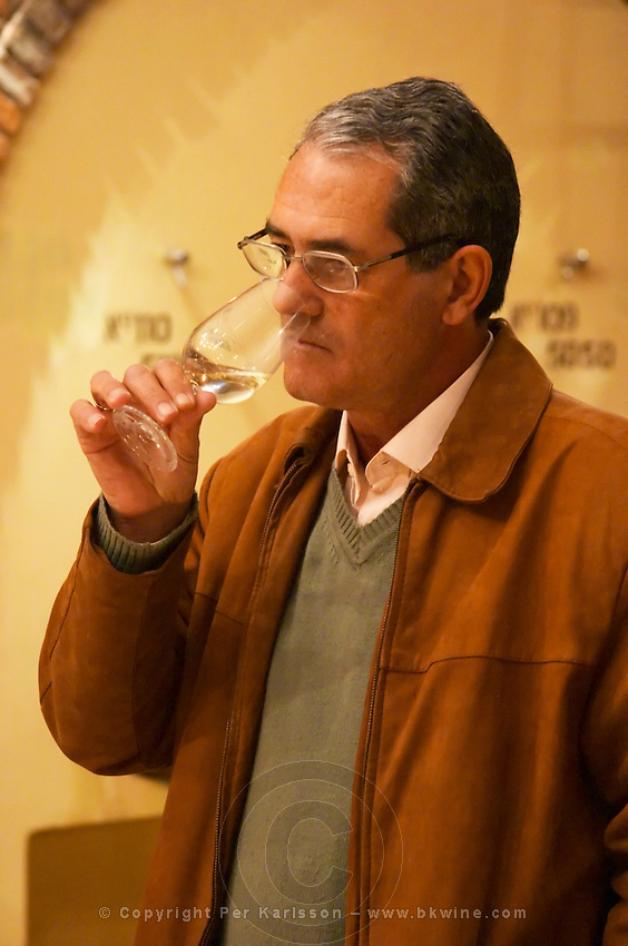The owner manager Edgardo J Etcheverry tasting a glass of wine. Bodega Castillo Viejo Winery, Las Piedras, Canelones, Uruguay, South America