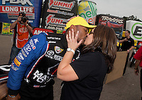 Mar. 17, 2013; Gainesville, FL, USA; NHRA top fuel dragster driver Antron Brown (left) kisses wife Billie Brown after winning the Gatornationals at Auto-Plus Raceway at Gainesville. Mandatory Credit: Mark J. Rebilas-
