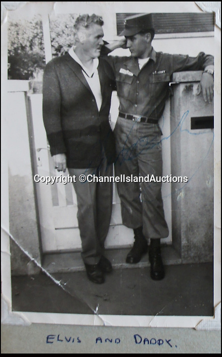 BNPS.co.uk (01202 558833)<br /> Pic: CIA/BNPS<br /> <br /> Elvis with his dad Vernon.<br /> <br /> A teenage girl's scrapbook containing unseen photos of Elvis Presley from his military service in Germany has been discovered after lying forgotten in a drawer for years.<br /> <br /> The owner compiled the album dedicated to the 'King' while she was working as a chambermaid in a hotel in Bad Nauheim, where Elvis spent most of his two years' national service.<br /> <br /> The book contains six signed photos of the star in his army uniform, signing autographs and posing with fans, including the owner of the album who was the only English girl in the town.