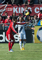 30 March 2013: Toronto FC midfielder Jonathan Osorio #21and Los Angeles Galaxy midfielder Landon Donovan #10 argue with the officials during an MLS game between the LA Galaxy and Toronto FC at BMO Field in Toronto, Ontario Canada..The game ended in a 2-2 draw..