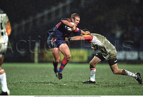 SEAN RUDDER, Bradford Bulls 41 v NEWCASTLE KNIGHTS 26, World Club Challenge, McAlpine Stadium,  020201. Photo: Neil Tingle/Action Plus...2002.rugby league.superleague.club clubs.hand-off hand off