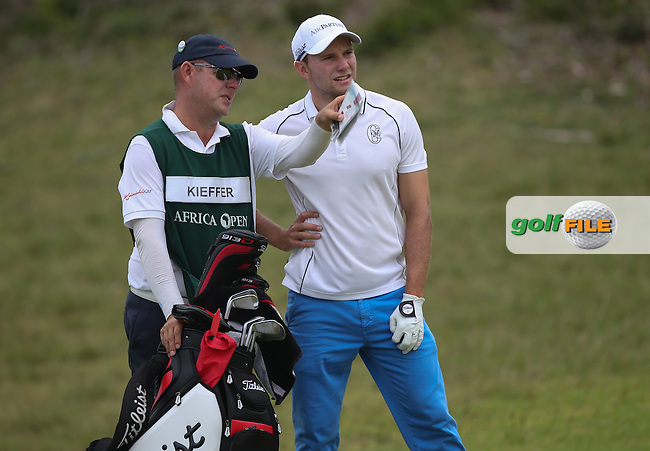 Caddie Graeme Heinrich gives Maximilian  Kieffer (GER) advice on the bond 5th during Round One of The Africa Open 2014 at the East London Golf Club, Eastern Cape, South Africa. Picture:  David Lloyd / www.golffile.ie
