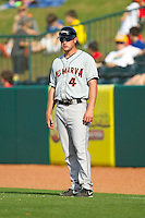 Delmarva Shorebirds player-coach Shawn Roof (4) coaches first base during the South Atlantic League game against the Greensboro Grasshoppers at NewBridge Bank Park on May 26, 2013 in Greensboro, North Carolina.  The Grasshoppers defeated the Shorebirds 11-2.  (Brian Westerholt/Four Seam Images)
