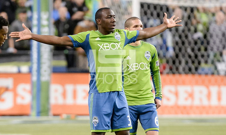 November, 2013: CenturyLink Field, Seattle, Washington: Seattle Sounders FC defender Jhon Kennedy Hurtado (34) stretches his arms in frustration  as the Portland Timbers defeat  the Seattle Sounders FC 2-1 in the Major League Soccer Playoffs semifinals Round.