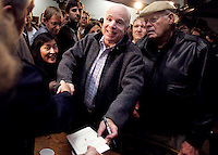 Republican presidential candidate Sen. John McCain greets supporters following a campaign event December 27, 2007 in Des Moines.
