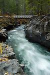A footbridge crosses the Rogue River, Rogue River National Forest, Oregon