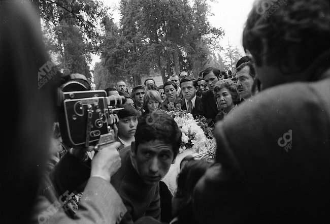 The funeral of Communist poet Pablo Neruda, who died shortly after the military coup that occured on September 11, 1973; Mme Neruda (light hair) is in the center. Santiago, Chile, September 1973.