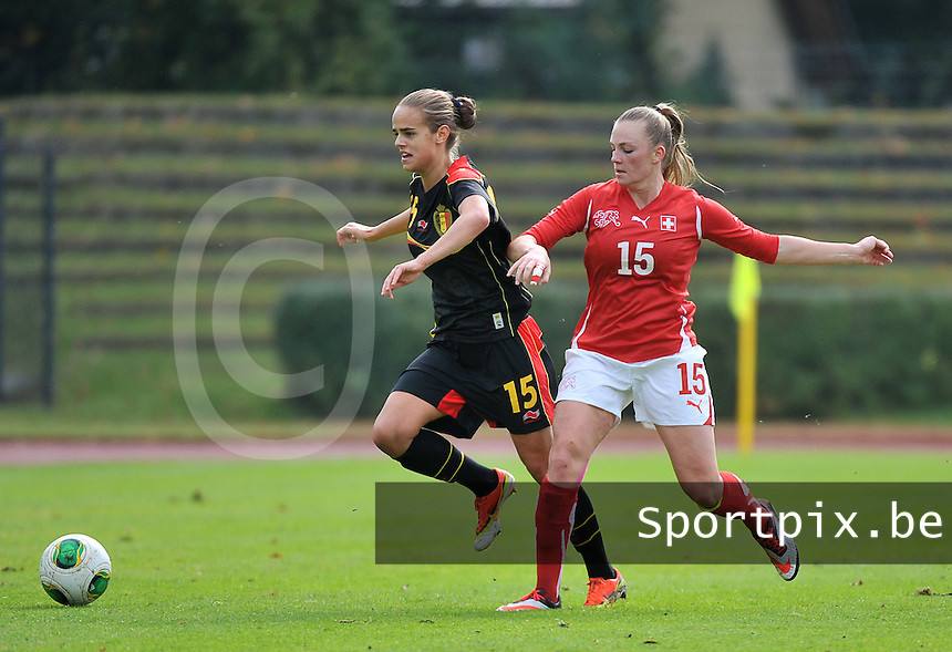 20131013 - BAMBERG , GERMANY :  Belgian Amber Maximus (left) pictured with Swiss Camille Surdez (right)  during the female soccer match between Switzerland Women U17 and Belgium U17 , in the second game of the Elite round in group 6 in the UEFA European Women's Under 17 competition 2013 in the Fuchs Park Stadion - Bamberg  Sunday 13 October 2013. PHOTO DAVID CATRY
