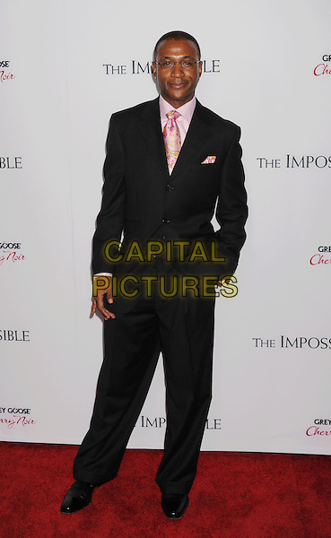 """Tommy Davidson.""""The Impossible"""" Los Angeles Premiere held at Arclight Cinemas, Hollywood, California, USA..December 10th, 2012.full length suit hand in pocket black pink paisley tie glasses .CAP/ROT/TM.©Tony Michaels/Roth Stock/Capital Pictures"""