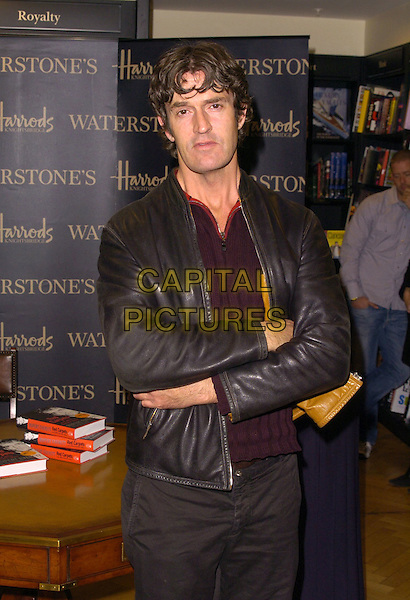 RUPERT EVERETT.At his Booksinging at Waterstones, Harrods, .London, England, October 7th 2006..half length black leather jacket arms crossed folded book signing.Ref: CAN.www.capitalpictures.com.sales@capitalpictures.com.©Can Nguyen/Capital Pictures