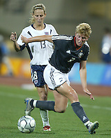 23 August 2004:  Kerstin Stegemann of Germany fights for the ball against Kristine Lilly of USA during the semifinal game at Pankritio Stadium in Heraklio, Greece.     USA defeated Germany, 2-1 in overtime.   Credit: Michael Pimentel / ISI