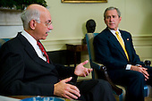 United States President George W. Bush makes brief remarks with Andrew S. Natsios, special envoy to Sudan, in the Oval Office of the White House in Washington, DC on Monday, October 2, 2006.<br /> Credit: Jay L. Clendenin - Pool via CNP