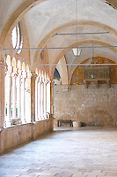 Interior arched courtyard of the Sainte Claire Sveti Klare convent Dubrovnik, old city. Dalmatian Coast, Croatia, Europe.
