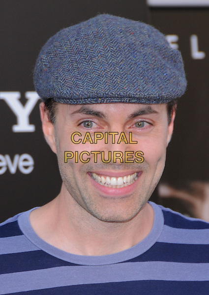 JAMES HAVEN.Premiere of SALT held at The Grauman's Chinese Theatre in Hollywood, California, USA. .July 19th, 2010         .headshot portrait blue striped cap hat navy grey gray herringbone smiling .CAP/RKE/DVS.©DVS/RockinExposures/Capital Pictures.