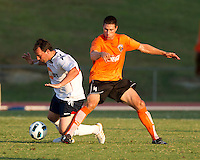 Brady Bryant (CE) makes a tackle on Robbie Blake (BW).  The Charlotte Eagles currently in 3rd place in the USL second division play a friendly against the Bolton Wanderers from the English Premier League.