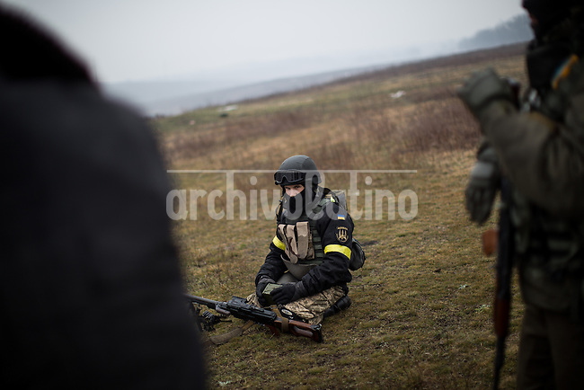 Ukranian soldiers training  for combat near the eastern city of  Mariupol , Ukraine. Most of them are civilian with little knowledge of army skills and weapons, they volunteered to fight  pro Rusian groups trying to seized the city.