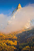 Autumn colours on the Aiguilles de Chamonix at sunset.