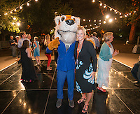 Alumni Reunion Weekend, Saturday, June 21, 2014. Kathryn (Arnold) Blitz '89 poses with a dressed up Oswald at the moonlight casino, dance and lounge after-party. Kathryn helped Oswald when she was a student at Oxy. (Photo by Marc Campos, Occidental College Photographer)