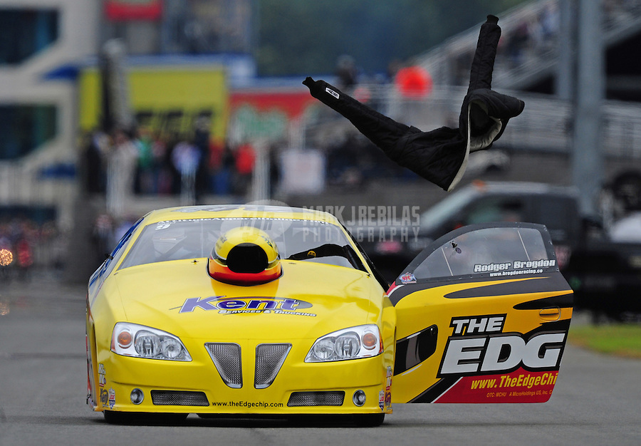 Sept. 17, 2011; Concord, NC, USA: The fire suit for NHRA pro stock driver Rodger Brogdon (not pictured) flies through the air after Brogdon threw it during qualifying for the O'Reilly Auto Parts Nationals at zMax Dragway. Mandatory Credit: Mark J. Rebilas-