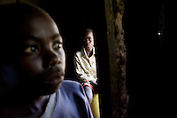 "Walter is 12 and Charles is 10. They are alone and they are invisible..""Nobody comes from the community to visit us here. They just look at us from the outside,"" Walter said looking out the door of the house he shares with his younger brother..They never knew their father. Their mother died  of AIDS in 2002 and in April  of 2008 their grandmother died.."