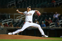 Salt River Rafters pitcher Yoan Lopez (32) delivers a pitch during an Arizona Fall League game against the Scottsdale Scorpions on October 13, 2015 at Salt River Fields at Talking Stick in Scottsdale, Arizona.  Salt River defeated Scottsdale 5-3.  (Mike Janes/Four Seam Images)