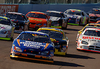 Nov 12, 2005; Phoenix, Ariz, USA;  Nascar driver Carl Edwards leads the field on the first lap of the Busch Series Arizona 200 at Phoenix International Raceway. Mandatory Credit: Photo By Mark J. Rebilas
