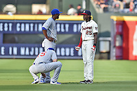 Chicago Cubs center fielder Dexter Fowler (24) and Atlanta Braves center fielder Cameron Maybin (25) before a game against the Atlanta Braves on July 18, 2015 in Atlanta, Georgia. The Cubs defeated the Braves 4-0. (Tony Farlow/Four Seam Images)