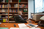 Dr Jean-Pierre Droz, Oncology unit, Centre Leon Berard, Lyon, France. The doctor in his office surrounded by books. On the computer.