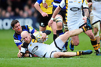 Joe Simpson of Wasps is tackled to ground by Adam Hastings of Bath Rugby. Aviva Premiership match, between Bath Rugby and Wasps on March 4, 2017 at the Recreation Ground in Bath, England. Photo by: Patrick Khachfe / Onside Images
