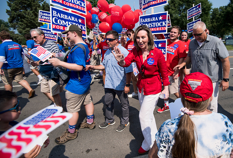 UNITED STATES - JULY 4: Rep. Barbara Comstock, R-Va., waves to the crowd in the Leesburg Independence Day Parade in Leesburg, Va., on July 4, 2018. Comstock facing Democrat Jennifer Wexton for Virginia's 10th Congressional district seat. (Photo By Bill Clark/CQ Roll Call)