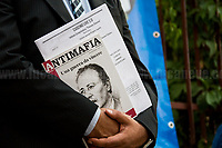 """Palermo (Sicily - Italy), 19/07/2017. """"Basta depistaggi e omertà di Stato!"""" (""""Stop disinformation & omertá by the State!"""")(1). Public event to commemorate the 25th Anniversary of the assassination of the anti-mafia Magistrate Paolo Borsellino along with five of his police """"scorta"""" (Escorts from the special branch of the Italian police force who protect Judges): Agostino Catalano, Emanuela Loi (The first Italian female member of the police special branch and the first woman of this branch to be killed on duty), Vincenzo Li Muli, Walter Eddie Cosina and Claudio Traina. The event was held at Via D'Amelio, the road where Borsellino was killed. Family members of mafia victims, amongst others, made speeches about their dramatic experiences, mafia violence and unpunished crimes, State cover-ups, silence ('omertá'), and misinformation. Speakers included, amongst others, Vincenzo Agostino & Augusta Schiera, Salvatore & Cristina Catalano, Graziella Accetta, Massimo Sole, Paola Caccia, Luciano Traina, Angela Manca, Stefano Mormile, Ferdinando Imposimato, Judge Nino Di Matteo. The event ended with the screening of the RAI docu-fiction, 'Adesso Tocca A Me' ('Now it's My Turn' - Watch it here: http://bit.ly/2w3WJUX ).<br /> <br /> For more info & a video of the event please click here: http://bit.ly/2eQfNT3 & http://bit.ly/2eQbmrj & http://19luglio1992.com & http://bit.ly/2he8hCj<br /> <br /> (1) 'Omerta' is the term used in Italy to refer to the code of silence used by mafia organisations, as well as the culture of silence that is entrenched in society at large (especially among victims of mafia crimes, as they fear recriminations), about the existence of organised crime and its activities."""